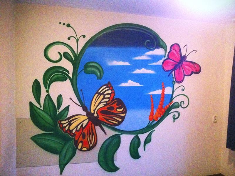 Slaapkamermuur met vlinders